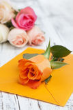 Flowers and a letter Royalty Free Stock Photos
