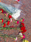 Flowers lie on a red granite Royalty Free Stock Photo