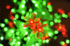 Flowers lights. Electric Christmas garland of red flowers Royalty Free Stock Photo