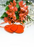 Flowers lily in color of the year 2019 - Living Coral. Livingcoral. Romantic bouquet and two red hearts for Valentines day dinner stock photography