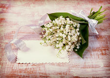 Flowers lily of the valley on the old boards. Vintage retro hips Royalty Free Stock Photography