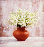 Flowers lily of the valley on the old boards. Vintage retro hips Stock Photo