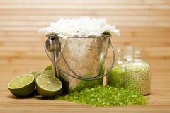 Flowers and Lime bath salt Stock Photos