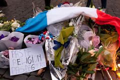 Flowers and lit candles in front of the French Embassy in Piazza Stock Photos