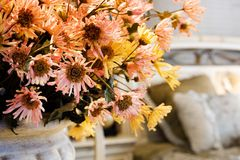 The flowers in living room. The red and yellow chrysanthemum (ikebana) in someone's home Stock Photography