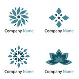 Flowers logos - blue. Set of four blue flowers logo isolated on white background.EPS file available Royalty Free Stock Photo