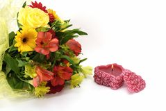 Flowers and love. А flowers and a candle isolated on white background Royalty Free Stock Photo