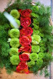 Flowers lovers and valentine. Picture of close up red and green roses and flowers Royalty Free Stock Photography