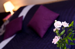 Flowers in luxurious bedroom Stock Images