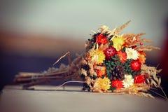 Flowers lying on stone. Autumn flowers lying on stone Royalty Free Stock Photos