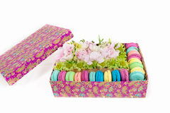 Flowers and macaroon in the box. Flowers bouquet with hydrangea and macaroon in the gift box Royalty Free Stock Images