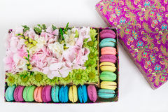 Flowers and macaroon in the box. Flowers bouquet with hydrangea and macaroon in the gift box Royalty Free Stock Image