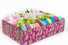 Flowers and macaroon in the box. Flowers bouquet with hydrangea and macaroon in the gift box Royalty Free Stock Photography