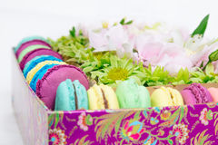 Flowers and macaroon in the box. Flowers bouquet with hydrangea and macaroon in the gift box Stock Photo