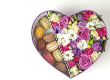 Flowers and macaroons Stock Photos