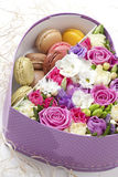 Flowers and macaroons Stock Image