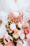 Flowers and macaroons in woman hands stock images