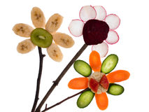 Flowers made of fruits of the earth. Royalty Free Stock Photo