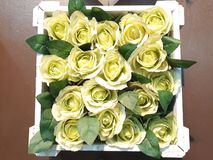 Flowers are made of light yellow fabric. stock photos