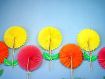 Flowers made from paper. Colorful flowers made from paper isolated on blue stock image
