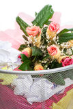 Flowers from a man in dust bin Stock Images