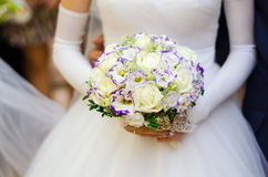 Flowers with many white roses in hands of bride Stock Photography