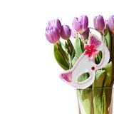 The flowers and mask. A bouquet of tulips anda mask stock photos