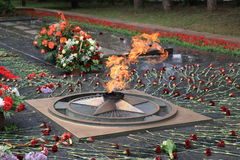 Flowers at the memorial Eternal Fire on Victory Day. Russia. Pyatigorsk, Russia - May 9, 2017: Flowers at the memorial Eternal Fire on Victory Day in Pyatigorsk Royalty Free Stock Photography