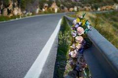 Flowers memorial symbol in a road royalty free stock images