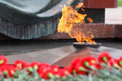 Flowers at memorial to tomb of Unknown Soldier. In Alexander Garden at Victory Day; Eternal Flame stock photography