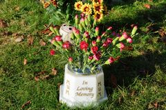 Flowers in Memoriam stone. In memory royalty free stock image