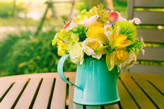 Flowers in metal vase Stock Photo