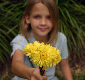 Flowers for Mom. Girl holding bunch of flowers Royalty Free Stock Images