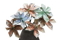 Flowers of money. Bouquet of flowers origami made by bills of different values of euro royalty free stock image