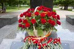 Flowers at a monument. Basket with roses and flowers at the monument Royalty Free Stock Photography