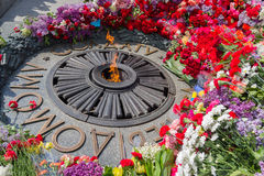 Flowers on Monument with Eternal fire to the unknown soldier. Kiev. Ukraine Stock Images