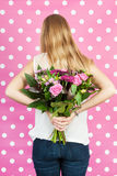 Flowers for mother. Fourteen year old girl with flowers for mother Stock Image