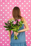Flowers for mother. Fourteen year old girl with flowers for mother Stock Photo