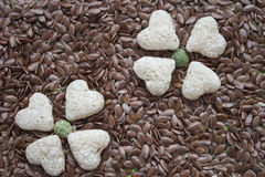Flowers of muesli. On grains of flax, texture Stock Images