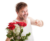 Flowers for My Sweetheart. Scruffy looking man in his underwear holding roses and pointing at you. Isolated on white royalty free stock image