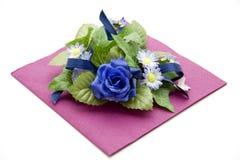 Flowers on napkin Stock Image