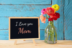 Flowers next to blackboard. happy mother's day concept Stock Photo