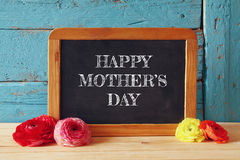 Flowers next to blackboard. happy mother's day concept Royalty Free Stock Photos