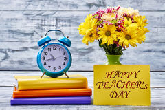 Flowers, notebooks, timer and card. Stock Photography