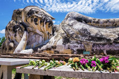 Flowers offered to the reclining Buddha of Wat Lokaya Sutha, Thailand. Flowers offered to the reclining Buddha of Wat Lokaya Sutha, Ayutthaya, Thailand Stock Photos