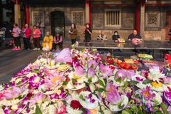 Flowers offerings in Buddhist temple Stock Image