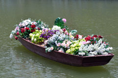 Flowers in old boat Stock Photos
