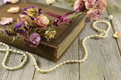 Flowers with the old book royalty free stock photography