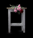 Flowers and old a stool Royalty Free Stock Photos