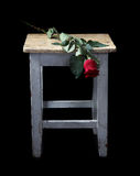 Flowers and old a stool Royalty Free Stock Images